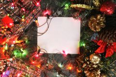 Christmas background blank paper and decoration with garland Stock Image