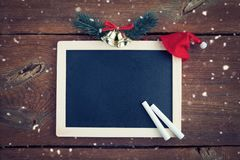 Christmas background with empty chalk board stock photo