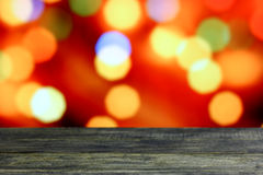 Christmas background with empty old dark wooden desk table. Stock Photography