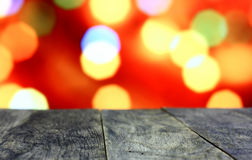 Christmas background with empty old dark wooden desk table.