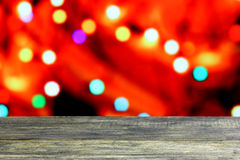 Christmas background with empty old dark wooden desk table. Royalty Free Stock Image