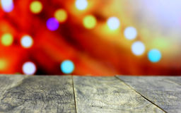 Christmas background with empty old dark wooden desk table. Royalty Free Stock Images