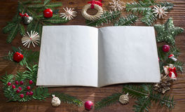 Christmas background with empty paper on wood Royalty Free Stock Photos