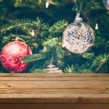 Christmas background with empty wooden table over Christmas tree decorations royalty free stock photos