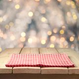 Christmas background with empty wooden table and tablecloth over abstract bokeh lights. Christmas background with empty wooden table and tablecloth over bokeh royalty free stock photos