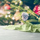 Christmas background with empty wooden table and tablecloth over Christmas tree decorations. Christmas background with empty wooden table and tablecloth over stock photos