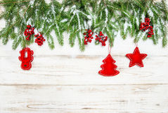 Christmas background. Evergreen tree with red berries and decora Royalty Free Stock Photography