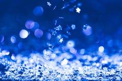christmas background with falling blue shiny stock image