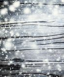 Christmas Background with falling snow. Snow over wood backdrop. Xmas Card Royalty Free Stock Photo