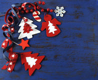 Christmas background with felt decorations on dark blue vintage wood. Royalty Free Stock Images