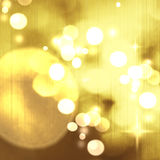 Christmas background. Festive abstract background with bokeh def. Ocused lights and stars Royalty Free Stock Photo