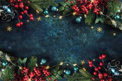 Christmas decor background with place for text. Christmas background with a festive decor, fir tree and place for text stock images