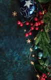 Christmas decor background with place for text. Christmas background with a festive decor, fir tree and place for text stock photography