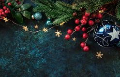 Christmas decor background with place for text. Christmas background with a festive decor, fir tree and place for text royalty free stock photo