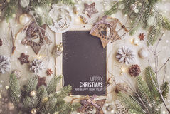 Christmas Background with Festive Decoration. Black Chalk Board and text - Merry Christmas and Happy New Year Stock Photos