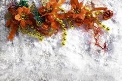 Christmas background with festive decoration on snowy background. Christmas festive background with flower toy decoration on snowy background stock photo