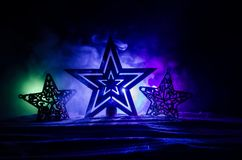 Christmas background with festive decoration, star on dark blue background with copyspace. Stock Images