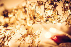 Christmas background with festive golden shining stars on garland Royalty Free Stock Photo