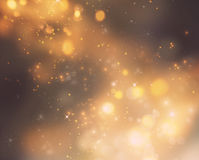Christmas background. Festive xmas abstract background with bokeh defocused lights and stars Royalty Free Stock Photo