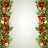 Christmas background with fir branch border and decoration. Christmas background with fir branch border with berry, Poinsettia flowers, ribbons and Christmas Royalty Free Stock Photos