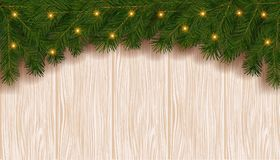 Christmas background with fir branch border and lights. Decorative Christmas festive background Stock Images