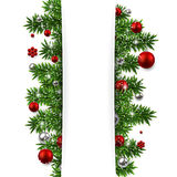 Christmas background with fir branches and balls. Stock Photos