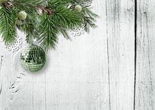 Christmas background with fir branches, berries and ball Royalty Free Stock Photo