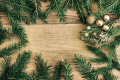 Christmas background with fir branches and Christmas decorations Stock Photos