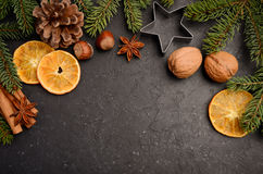 Christmas background with fir branches, cones, nuts and slices of dried orange. Royalty Free Stock Photography
