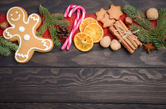 Christmas background with Fir Branches, Cones, Spices and Gingerbread. Royalty Free Stock Photo