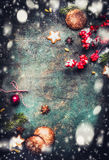 Christmas background with fir branches, cookies , gingerbreads and snow, top view frame Stock Image