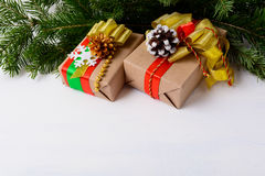 Christmas background with fir branches and decorated gift boxes Stock Photography
