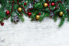 Christmas background with fir branches and decorations covered with snow Royalty Free Stock Image
