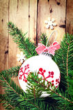 Christmas background with  fir branches and festive ornaments ov Royalty Free Stock Photo