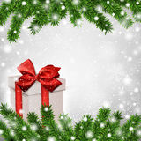 Christmas background with fir branches gift box. Royalty Free Stock Photo