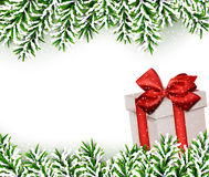 Christmas background with fir branches gift box. Royalty Free Stock Photos