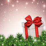 Christmas background with fir branches gift box. Royalty Free Stock Image