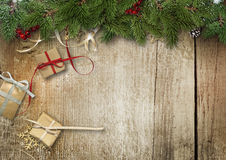 Christmas background with fir branches,gift box and holly on the Royalty Free Stock Photography