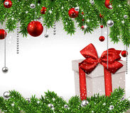 Christmas background with fir branches and gift box. Stock Image
