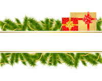 Christmas background with fir branches and gifts Royalty Free Stock Images