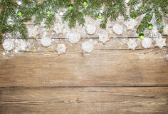 Christmas background of fir branches and ginger cookies stock image