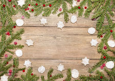 Christmas background of fir branches and ginger cookies stock images