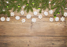 Christmas background of fir branches and ginger cookies Stock Photo