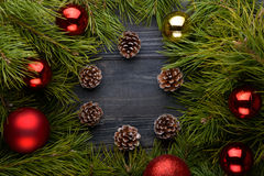 Christmas background with fir branches,pine cones on the old woo Royalty Free Stock Images