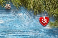 Christmas background with fir branches and winter heart on blue Stock Photography