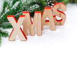Christmas background with fir branches and wooden letters Royalty Free Stock Photography