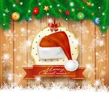 Christmas background with fir and Christmas hat Stock Photography