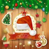 Christmas background with fir and Santa's hat Stock Images