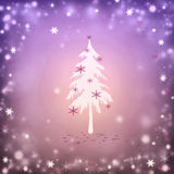 Christmas. Background with a fir and snowflakes Royalty Free Stock Image