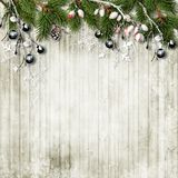 Christmas background with fir tree and berries at wooden table. Christmas background with a border of twigs and berries on wooden vintage boards. with a place Royalty Free Stock Images